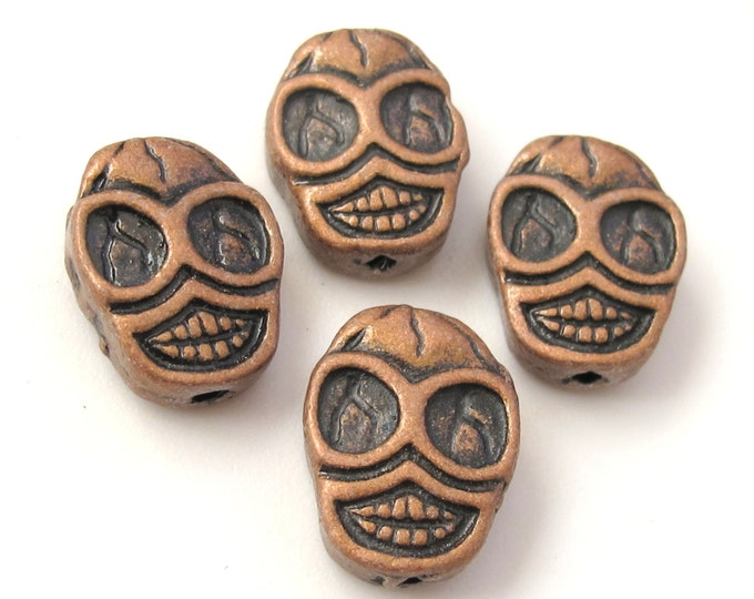 Copper finish metal skull beads - 4 pieces - BD352