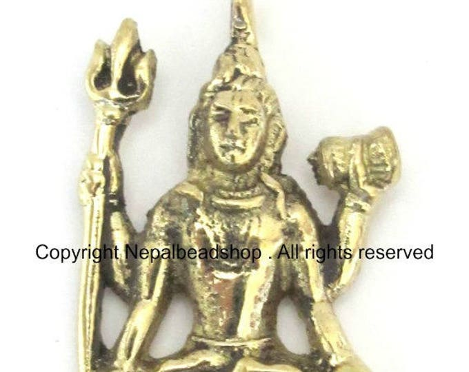 Hindu Lord Shiva seated with trident and dumru brass pendant - CP041 custom design copyright Nepalbeadshop