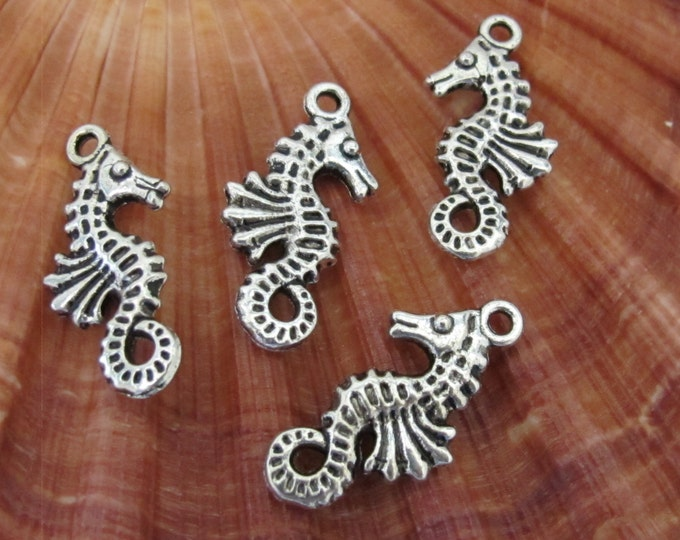8 sea horse reversible charms antiqued silver tone 22 mm x 11 mm  - CM042