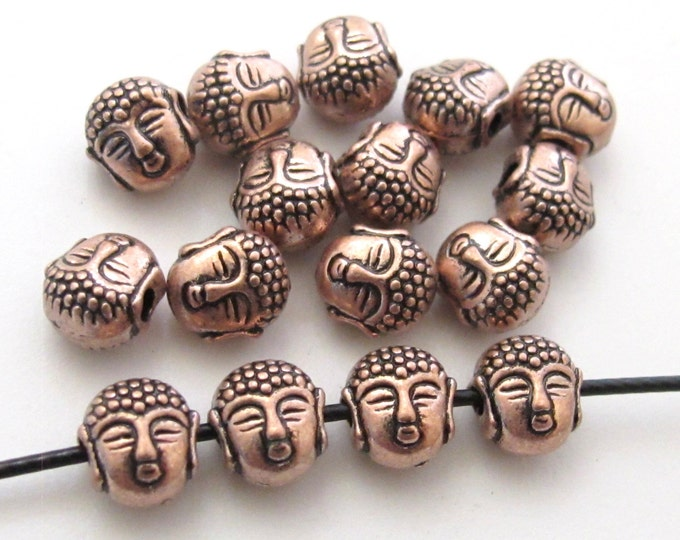 Small size reversible Tibetan Buddha copper tone plated brass beads - 4 beads - BD422