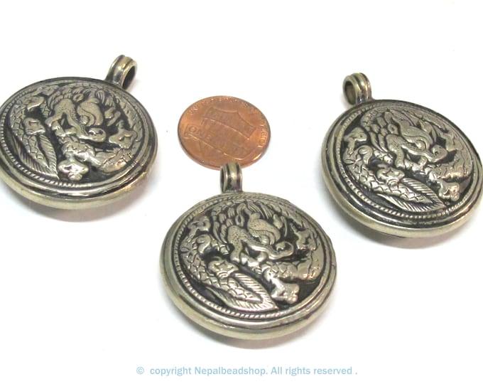 3 Pendants - Tibetan antiqued silver finish reversible dragon pendant ethnic design filigree repousse carving Nepal  - PM615s