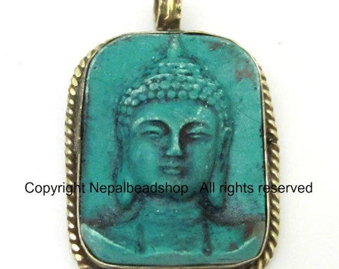 Tibetan green color Buddha face pendant from Nepal - PS001C copyright Nepalbeadshop