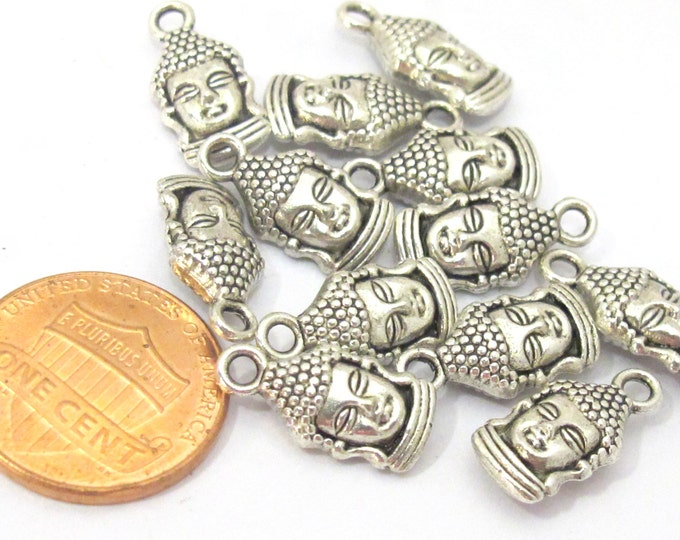 6 pieces-  Reversible antiqued silver tone Budddha face charms 16mm x 8mm - CM111