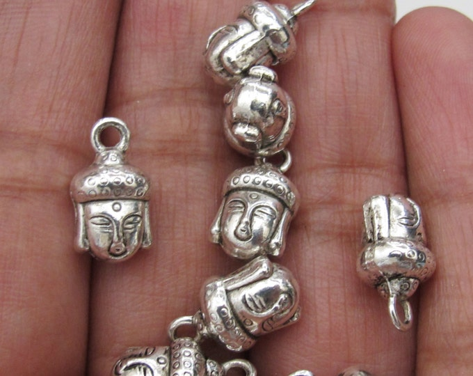 6 pieces - Reversible silver tone Buddha head charms - CM016