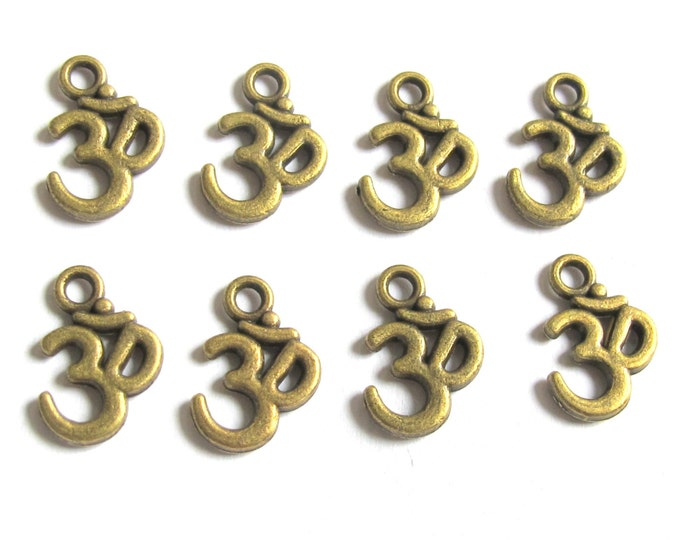 Brass tone yoga meditation om metal charms beads - 10 pieces - BD329