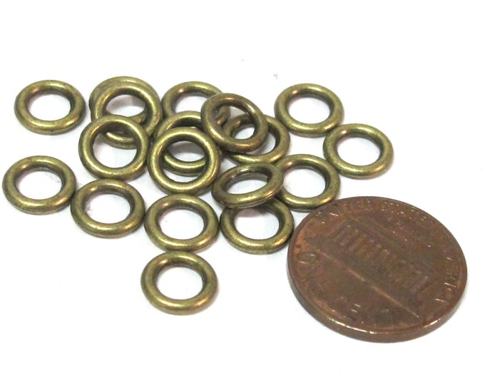 20 Beads - Antiqued brass color metal alloy donut shape ring beads 8 mm size - BD113A