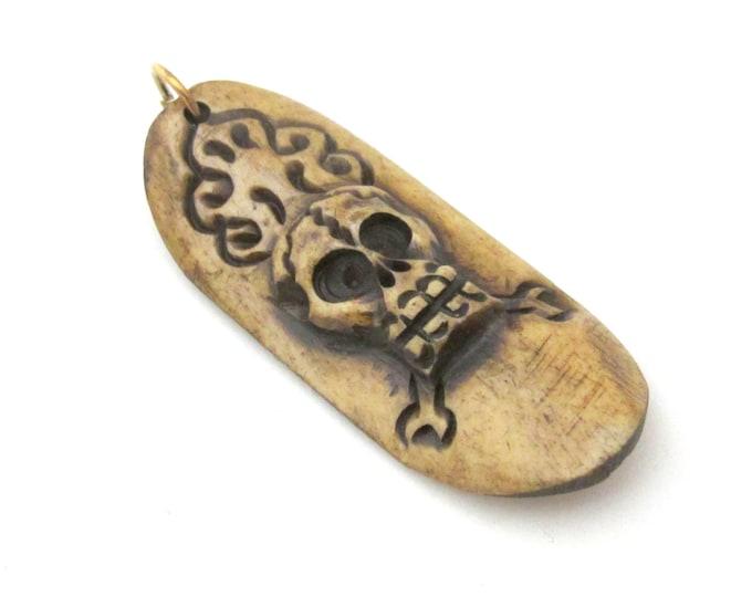 1 Pendant - Tibetan skull design carved convex bar shape bone pendant  from Nepal - PB106