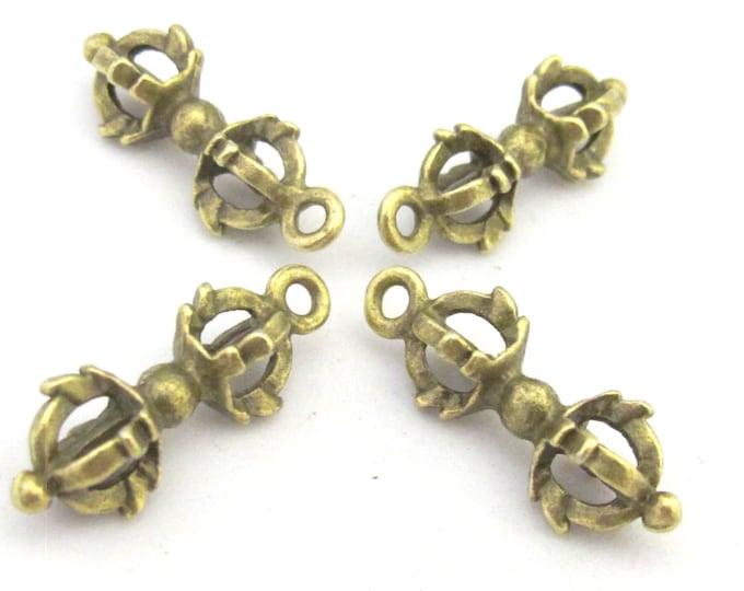 4 Charms - Tibetan vajra dorje antiqued brass tone charms  - CM104