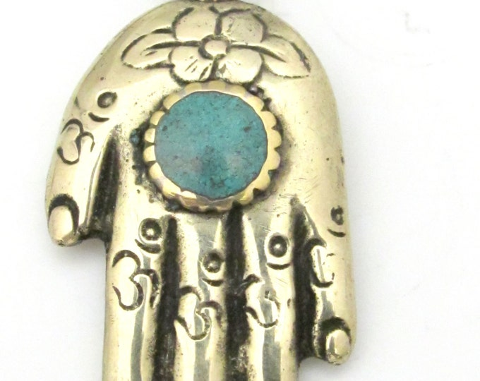 Reversible Tibetan silver Buddha hand Om pendant with turquoise inlay and flower details  -  PM331D