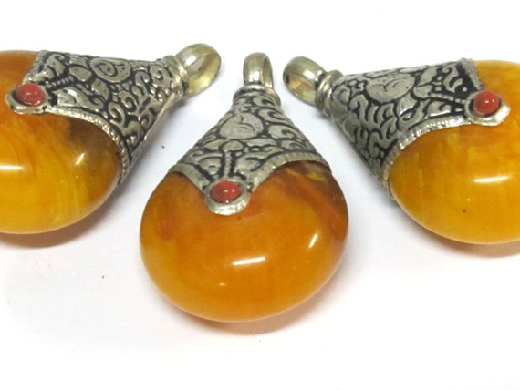 Ethnic Tibetan triangular arrowhead shape coral inlaid pendant from Nepal  with lotus flower on reverse side 1 Pendant PM585A