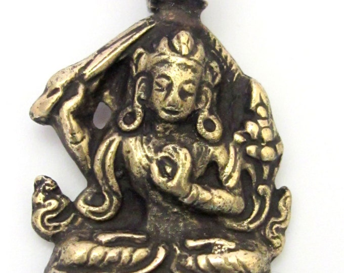 Tibetan solid Brass Manjushri pendant with reverse floral filigree from Nepal - CP070
