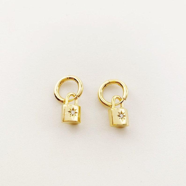 Gold Lock Starburst Earrings image 0