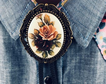68930127a8b6 Western Framed Pink and Maroon Roses Bolo Tie with Bronze Frame and Bronze  Tips