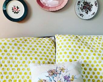 Decorative vintage tea towel pillow.