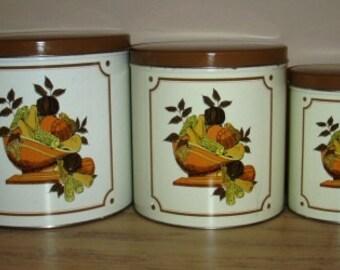 vintage tinware ... set of THREE Golden HARVEST CANISTER Set ...  Vintage household kitsch