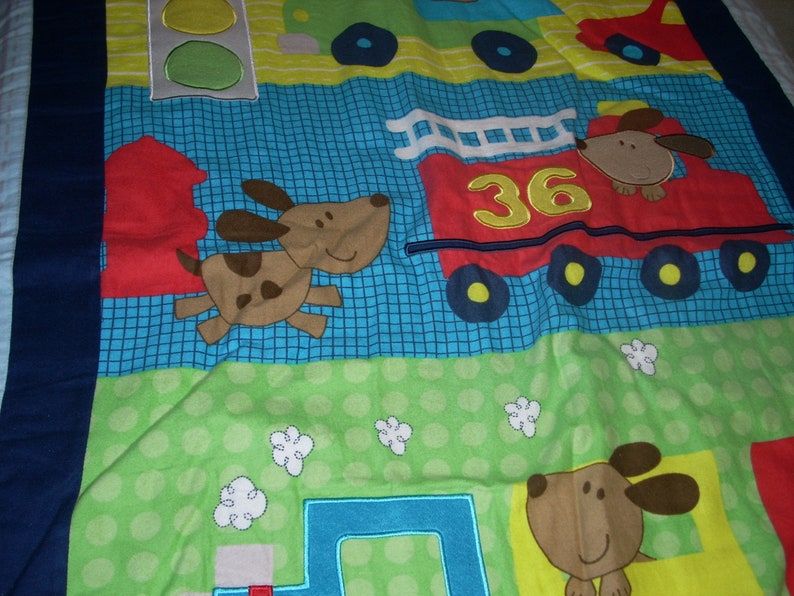 by 34 inches wide 40 inches long Firetruck and Train cotton front and blue fleece backing small size Blanket Puppy in Truck