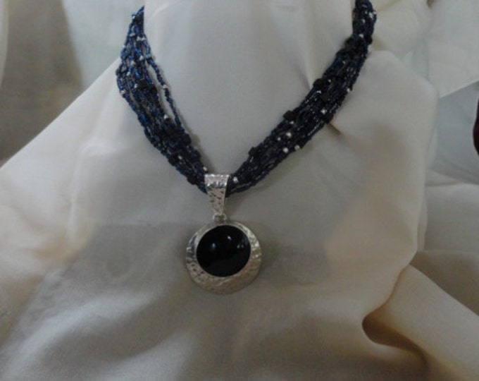 Multi-strand Necklace with Hammered Silver and Onyx Pendant