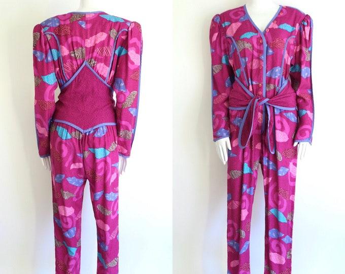 80s JEANNE MARC vintage jumpsuit size L / 1980s magenta rayon graphic print one piece suit w/ sash tie pants sz 12
