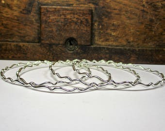 Set of silver Bangles