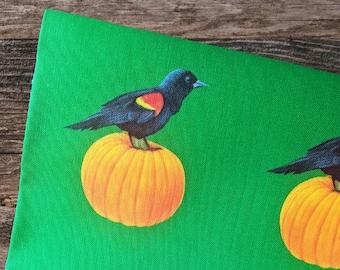 Red Winged Blackbird on a Pumpkin Linen Tea Towel by SBMathieu