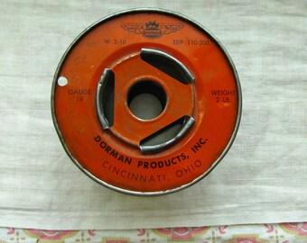 Vintage Orange Colored Advertising Metal Wire Spool Industrial