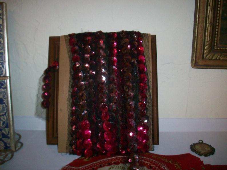 metallic sequins on black silk tulle antique trim