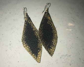 Hand painted black leather feather with gold accent.