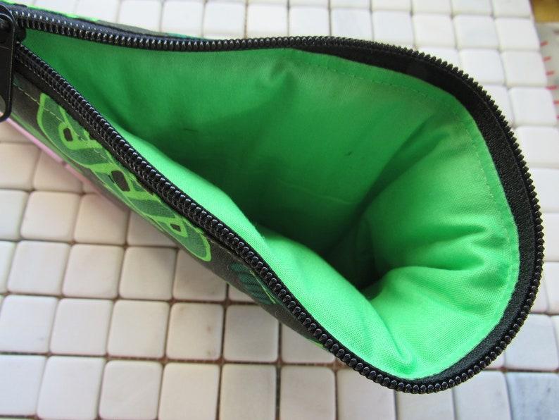 black and green celtic knot padded zipper bag