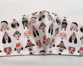 Dogs in Hats Face Mask. Quality Cotton Fabric. Nose Wire and Inner Pocket for a Filter. Ear Cord Adjusts for size and comfort. Washable.