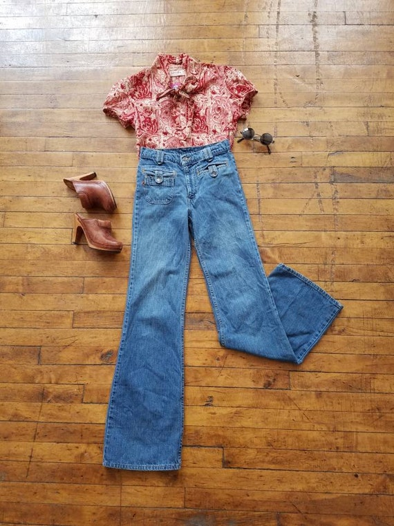 vintage 70s Levis Levi Strauss denim jeans high waist wide leg bell bottom flair rare orange feather tab super model faded hippie boho