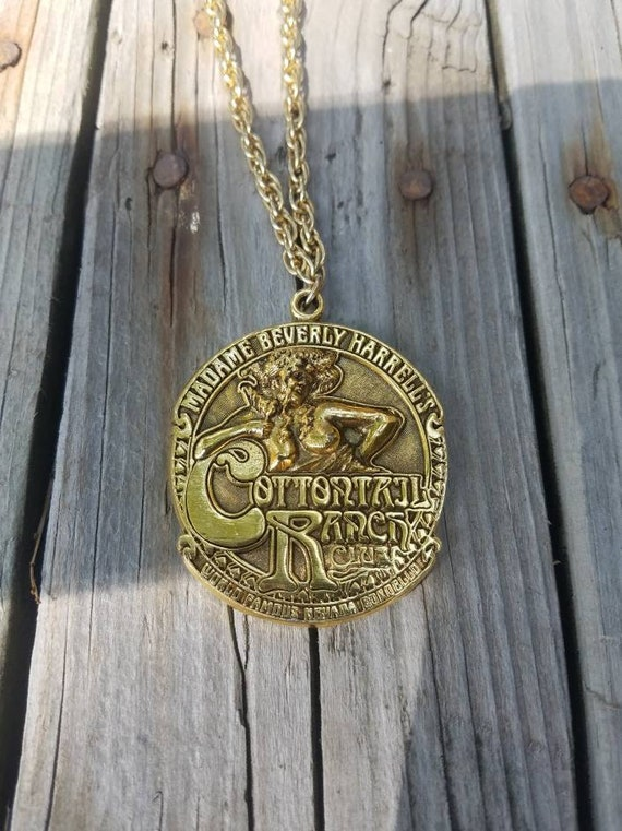 Vintage 1970s 70s Cottontail Ranch Club Nevada brothel large gold pendant necklace chain dated 1975 stamped artist