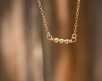 Peas in a Pod Necklace gold filled handmade layering delicate beaded dainty three beads simple everyday aden and claire jewelry