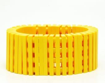 Yellow striped bracelet made with LEGO bricks