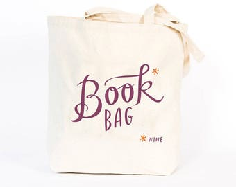 Book* (wine) Tote Bag by Emily McDowell