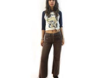 vintage 60s 70s brown denim hip hugger bells bell bottoms // low rise wide legged jeans // boho hippie cowgirl flower child