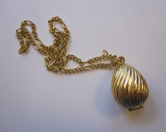 vintage AVON gold tone egg pendant - empty solid perfume pendant egg with gold tone chain