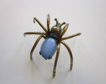 vintage SPIDER BROOCH - brass lets, rhinestone accents - blue cabochon body - circa 1930s