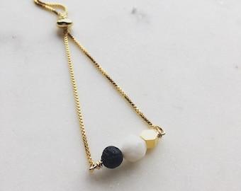 Moonstone and lava essential oil mixed beads bracelet, adjustable gold bracelet, slider bead bracelet