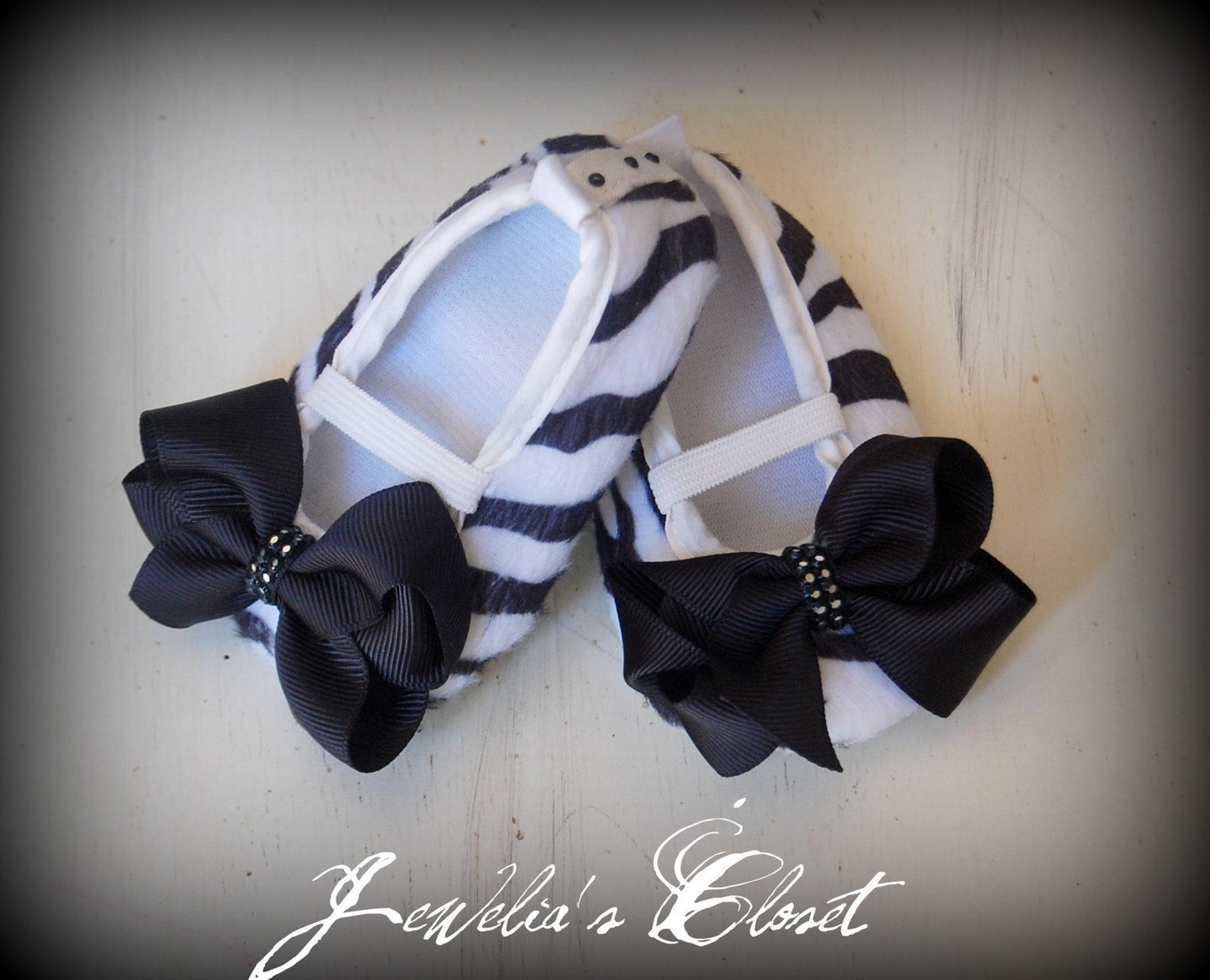 black and white zebra print ballet flat baby shoes with black grosgrain bows