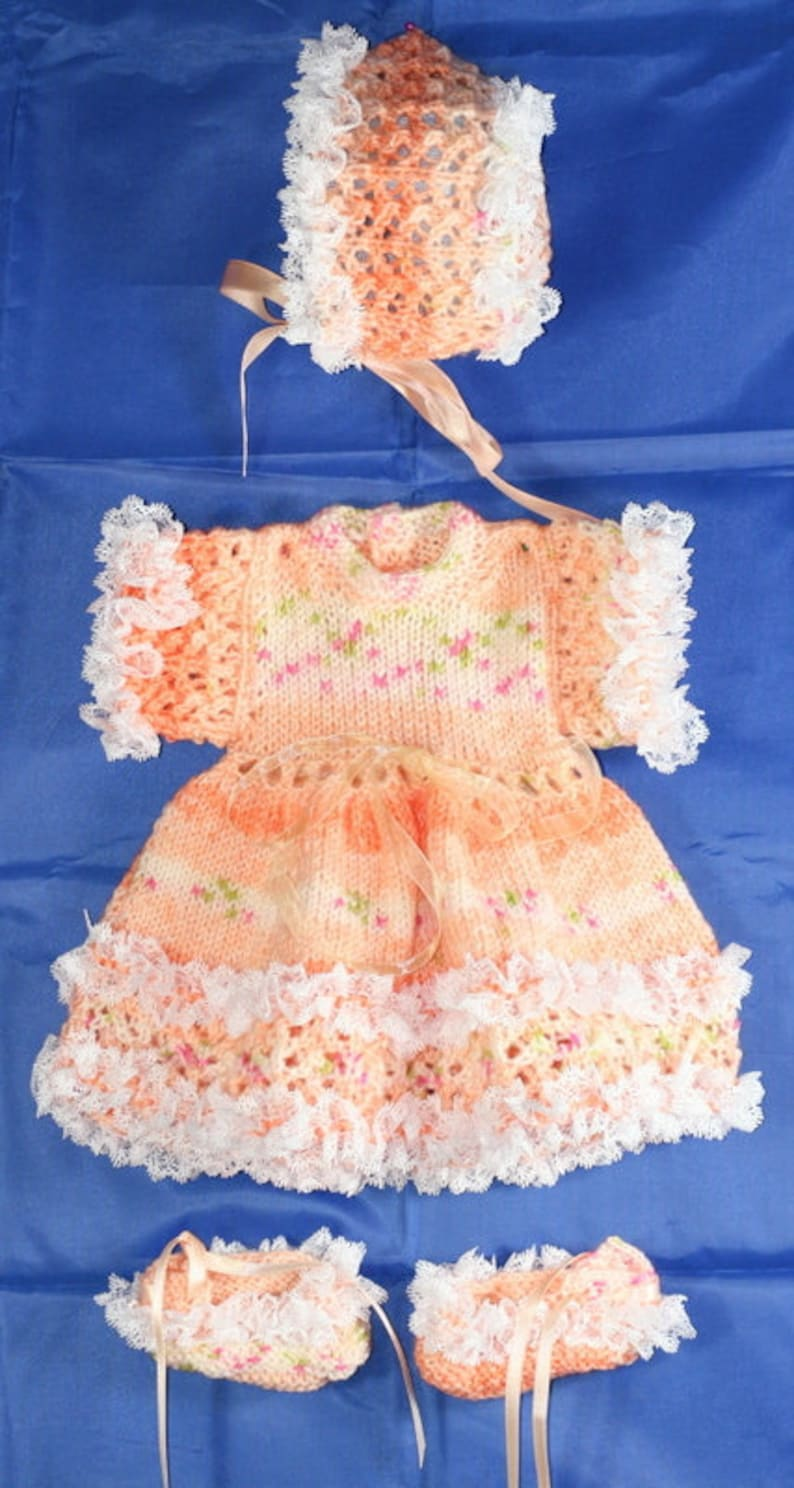 hat /& bootees to fit reborn doll or prem Peach coloured dress baby. Hand Knitted