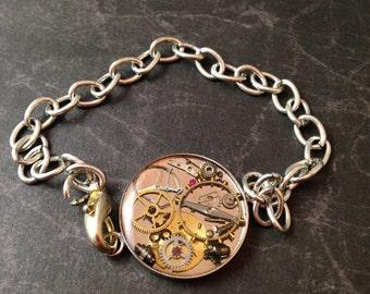 Silver Tone Round Clockwork Clutter Bracelet