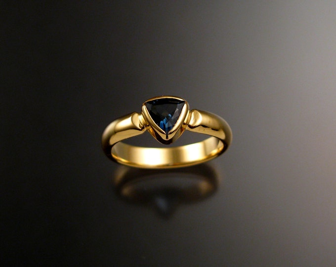 London Blue Topaz Triangle ring set in 14k Yellow Gold