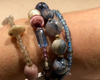 Fun set of pale blue and periwinkle stretch bracelets--glass, satin and marbled