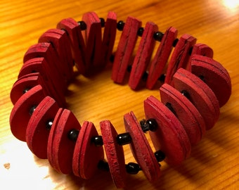 Fun, lightweight red coco shell stretch bracelet, made in Indonesia