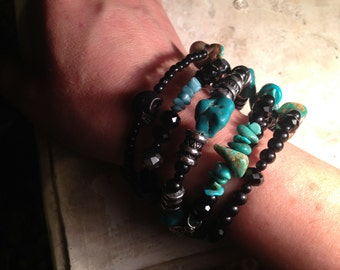 Black and Turquoise memory wire bracelet with silver accents and skulls