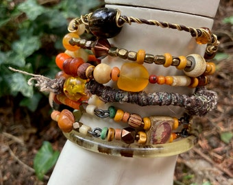 Rustic, tribal gypsy style beaded Bangle Stack in shades of amber, orange and bronze,