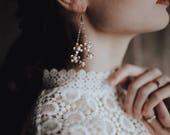 Flower wreath earrings with howlite centers, #1702