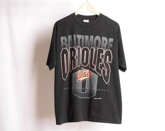 1e621828 vintage 1990s BALTIMORE ORIOLES cal ripken jr era BASEBALL black and orange  t-shirt -- size large