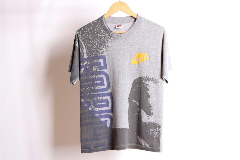 a9f30c561 Vintage NIKE 90s swoosh Michael Jordan size small t-shirt