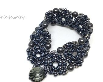 hematite pearl cuff bracelet . dark grey . gray . cuff style . dramatic . unique . jewelry . bracelet . swarovski
